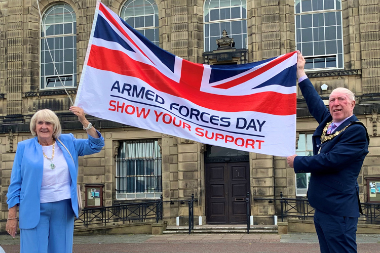 Mayor and Mayoress of Wirral proudly raise the Armed Forces Day flag at Wallasey Town Hall
