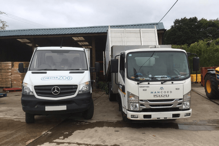 Chester Zoo and Man Coed VM Ltd vans parked alongside one another