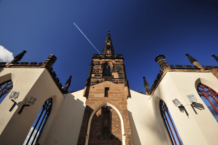 Birkenhead Priory seen from ground level, looking up towards the sky