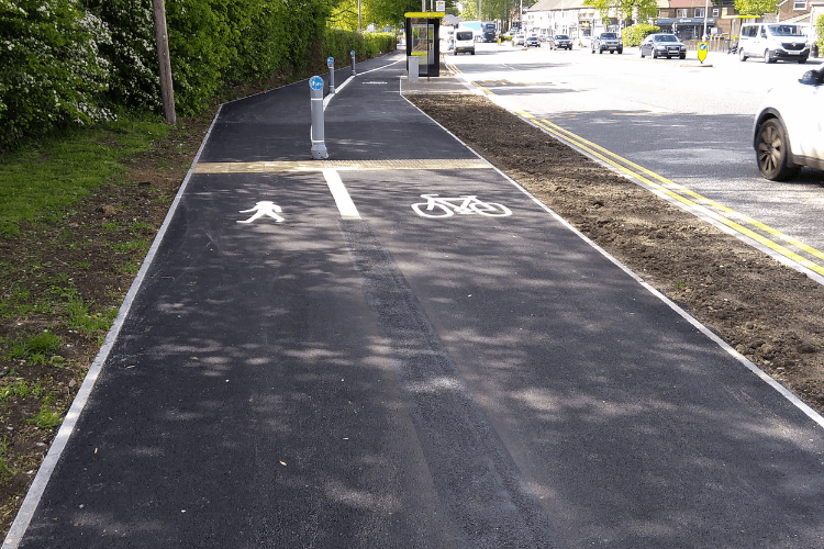 New wide path on the route between Eastham Village and junction 5 (Hooton) split with pedestrians on one side and cyclists on the other.