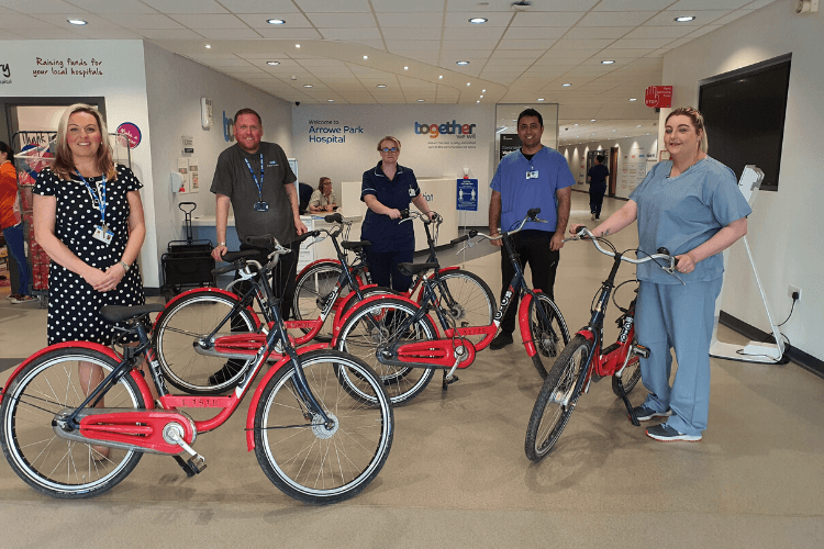 NHS staff from Arrowe Park Hospital standing with the first set of bikes received as part of HYPE Merseyside's campaign