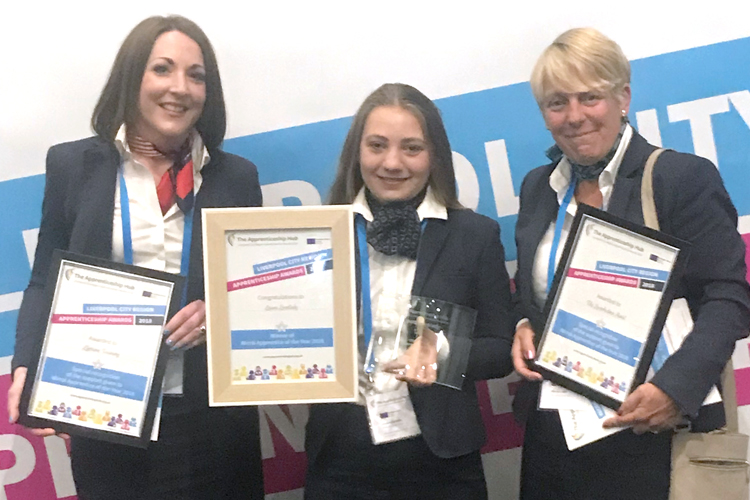 Hotel apprentice Laura Lovelady (centre) with her award