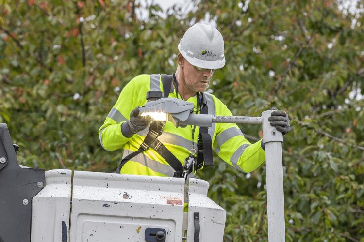 Worker fixing a streetlight