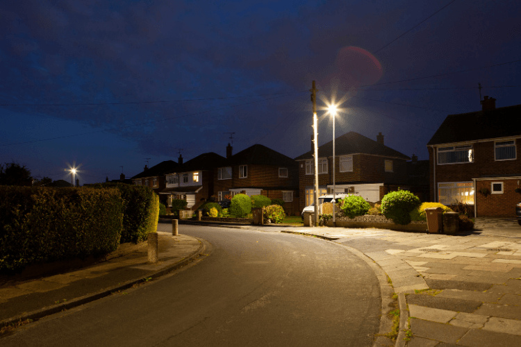 Road with two brightly lit streetlights