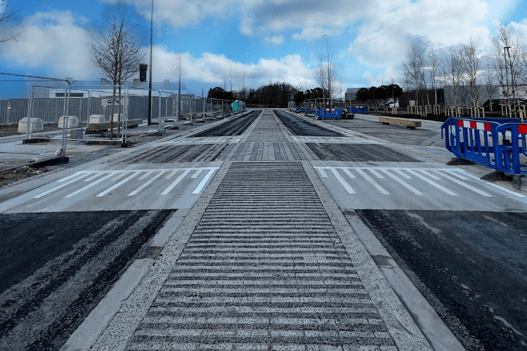 The new road layout at Tower Road with narrower lanes of road and wider pavements.