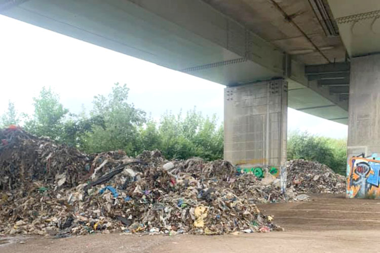 Mounds of flytipping at the M53 junction one