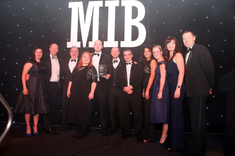The High-Impact team on stage at the Merseyside Independent Business Awards