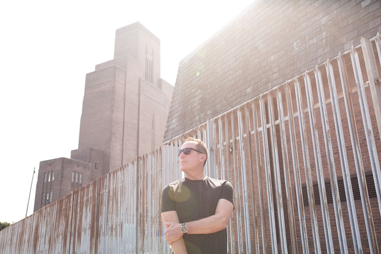 Andy McCluskey from OMD in front of the of Birkenhead tunnel ventilation tower