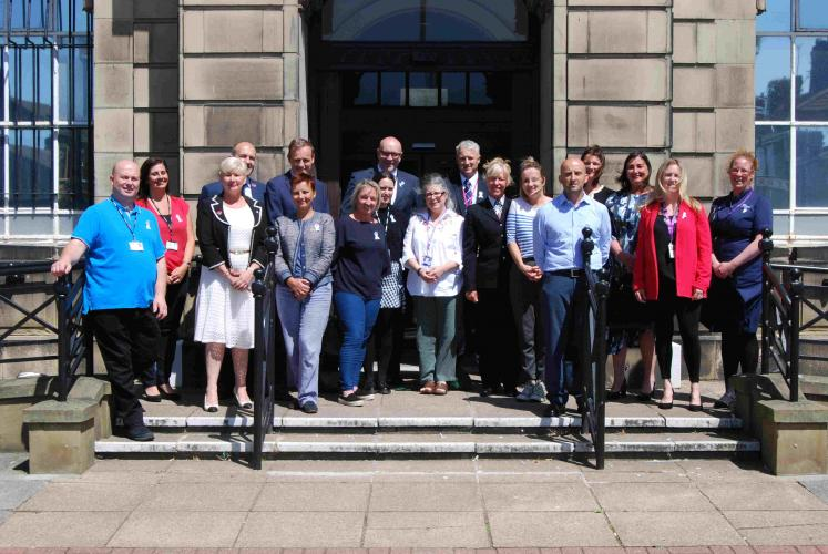 Cllrs Paul Stuart and Anita Leech are joined by partners of Wirral's Domestic Abuse Committee outside Wallasey Town Hall